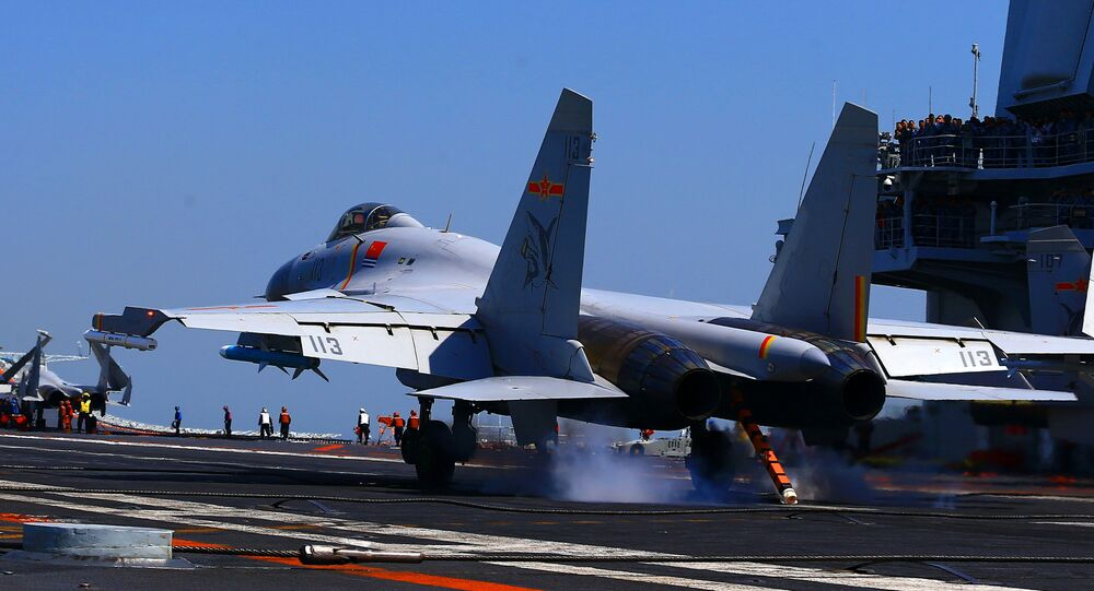 This photo taken on April 24, 2018 shows a J15 fighter jet landing on China's sole operational aircraft carrier, the Liaoning, during a drill at sea