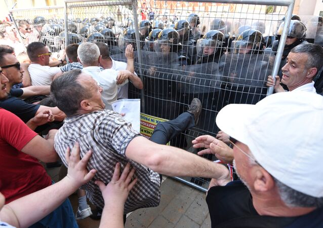 Albanian opposition supporters clash with riot police during a rally demanding the resignation of the Albanian Interior Minister whose brother is suspected of drug smuggling in Tirana on May 26, 2018