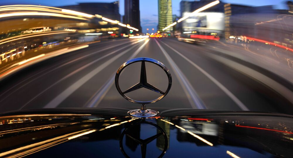 The star emblem on the hood of a driving Mercedes-Benz is seen near Potsdam Square, Potsdamer Platz, in Berlin