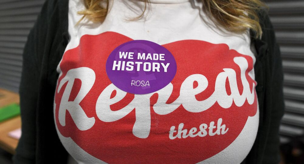 An activist shows off her campaign badge and T-shirt at the count center as votes are tallied following yesterday's referendum on liberalizing abortion law, in Dublin, Ireland, May 26, 2018.