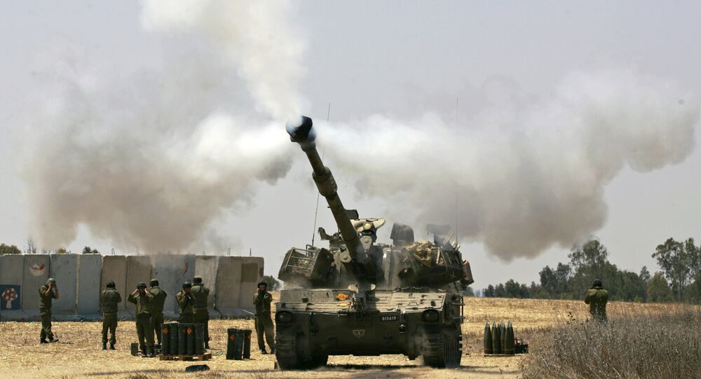 An Israeli army tank fires towards the Gaza Strip (File)