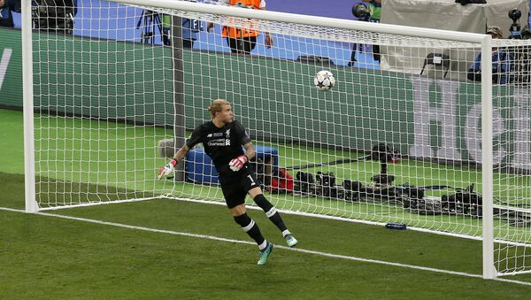 Liverpool goalkeeper Loris Karius looks at the ball after Real Madrid's Gareth Bale scored his side's 3rd goal during the Champions League Final soccer match between Real Madrid and Liverpool at the Olimpiyskiy Stadium in Kiev, Ukraine, Saturday, May 26, 2018 - Sputnik International