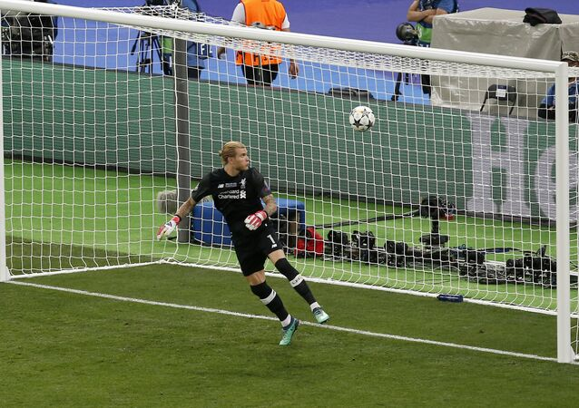 Liverpool goalkeeper Loris Karius looks at the ball after Real Madrid's Gareth Bale scored his side's 3rd goal during the Champions League Final soccer match between Real Madrid and Liverpool at the Olimpiyskiy Stadium in Kiev, Ukraine, Saturday, May 26, 2018