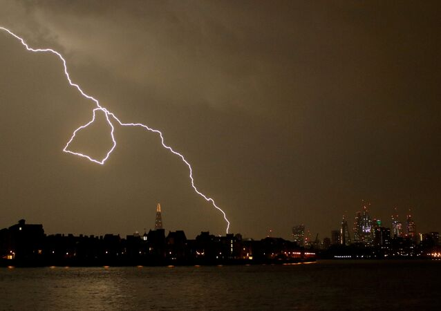 General view as lightning strikes over the city of London, Britain May 26, 2018