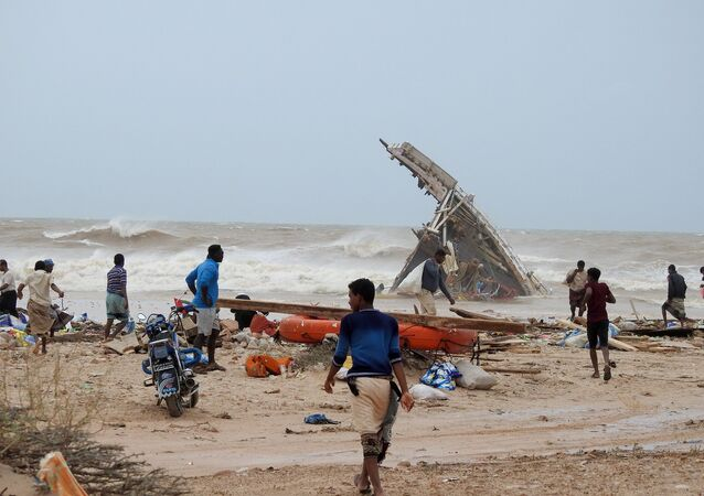 People search among the wreckage of a boat destroyed by Cyclone Mekunu in Socotra Island, Yemen, May 25, 2018