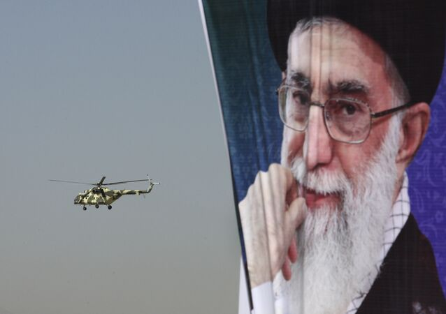 A police helicopter flies behind a poster of Iranian supreme leader Ayatollah Ali Khamenei