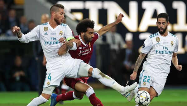 From left: Sergio Ramos from Real Madrid FC (Madrid, Spain), Mohamed Salah from Liverpool FC (Liverpool, England) and Isco from Real Madrid FC during the 2017-2018 UEFA Champions League final match between Liverpool FC and Real Madrid FC - Sputnik International
