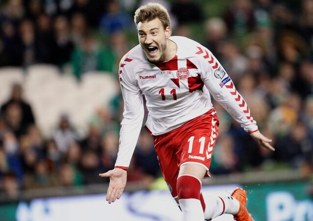 In this Tuesday, 14 November 2017 photo, Denmark's Nicklas Bendtner celebrates after scoring his team's fifth goal during the World Cup qualifying play off second leg match between Ireland and Denmark at Aviva Stadium in Dublin, Ireland