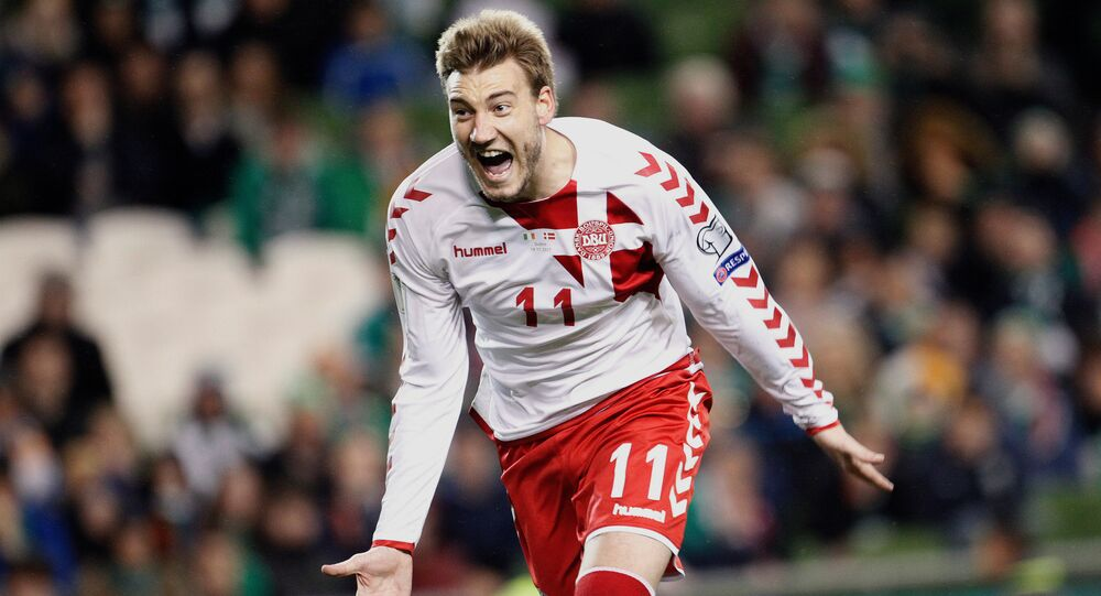 In this Tuesday, Nov. 14, 2017 filer, Denmark's Nicklas Bendtner celebrates after scoring his side's fifth goal during the World Cup qualifying play off second leg soccer match between Ireland and Denmark at the Aviva Stadium in Dublin, Ireland