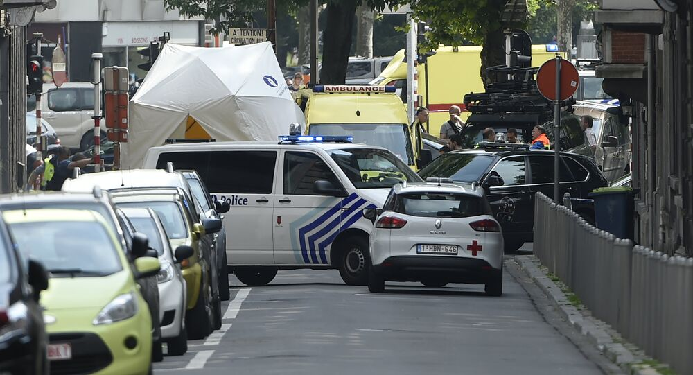 Police and ambulance are seen at the site where an armed man shot and killed police officers before being subdued by police in the eastern Belgian city of Liege on May 29, 2018