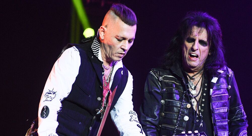 Actor Johnny Depp, left, and American rock musician Alice Cooper during a performance at the Olimpiysky sports complex.
