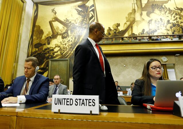 U.S. Ambassador Robert Wood walks out in protest at Syria's presidency of the Conference on Disarmament at the United Nations in Geneva in Geneva, Switzerland May 29, 2018