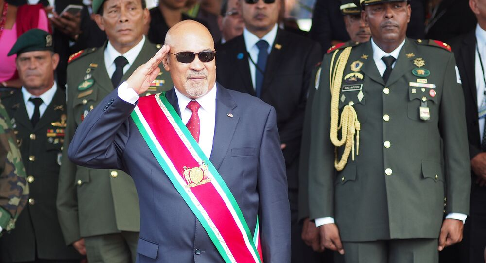 Surinamese President Desire Bouterse salutes during a military parade, after being sworn in for his second term in 2015