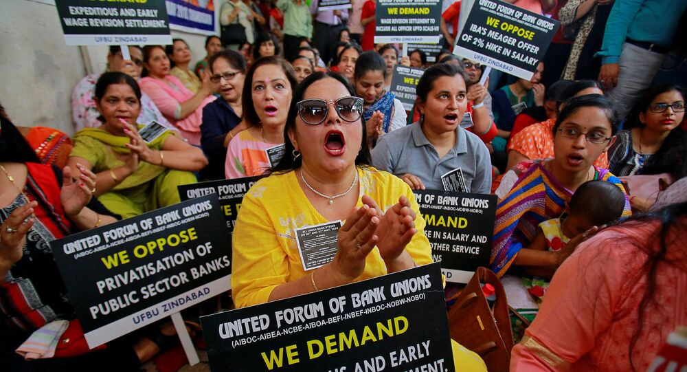 Bank employees shout slogans and carry placards during a protest, as part of a 48-hour long strike, in Chandigarh, India, May 30, 2018