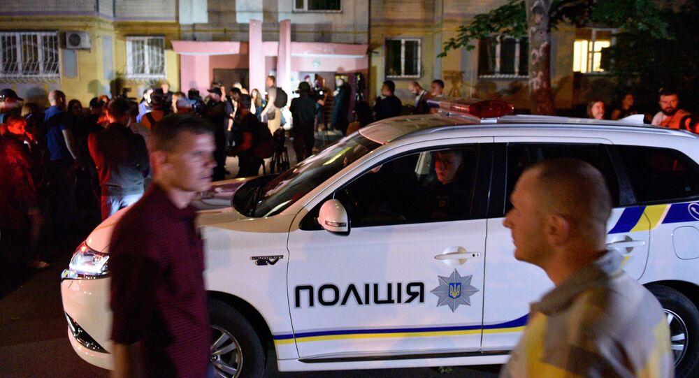 Police and journalists outside a building in Kiev where Russian journalist Arkady Babchenko was shot dead
