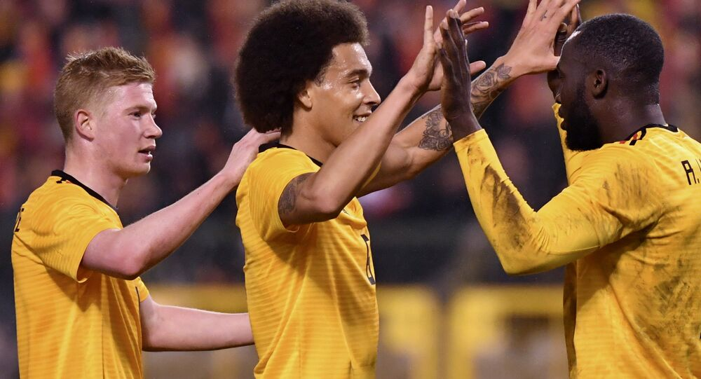 Belgium's Romelu Lukaku (right) is congratulated by team-mates Kevin de Bruyne (left) and Axel Witsel after scoring during a friendly in March 2018
