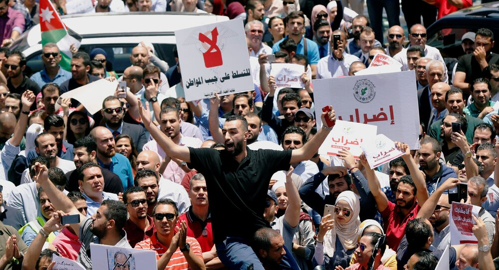 Jordanian people and associations chant slogans during a strike against the new income tax law, in Amman, Jordan May 30, 2018