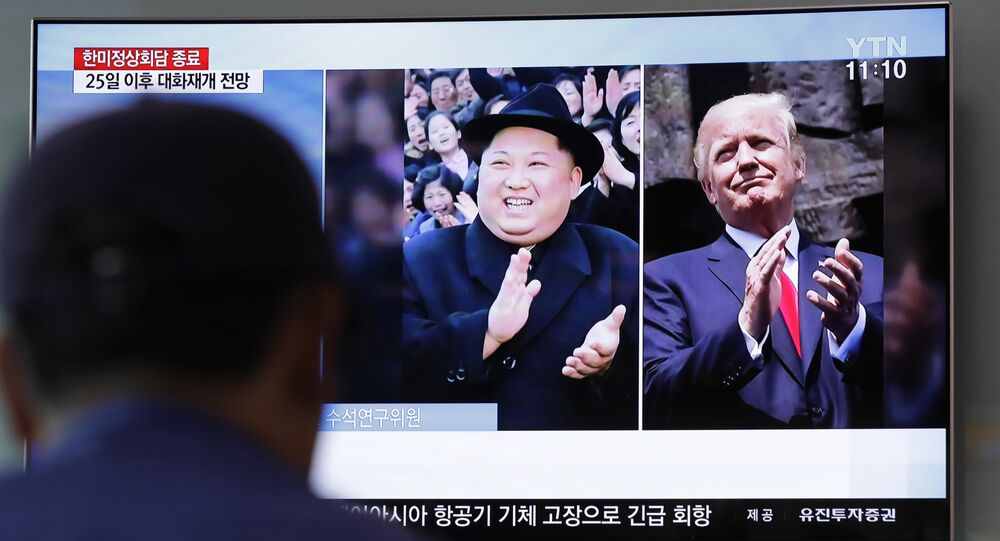 A man watches a TV screen showing file footage of US President Donald Trump, right, and North Korean leader Kim Jong-un, left, during a news program at the Seoul Railway Station in Seoul, South Korea, May 23, 2018