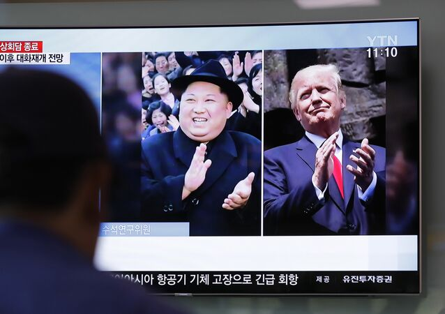 A man watches a TV screen showing file footage of U.S. President Donald Trump, right, and North Korean leader Kim Jong Un, left, during a news program at the Seoul Railway Station in Seoul, South Korea, Wednesday, May 23, 2018