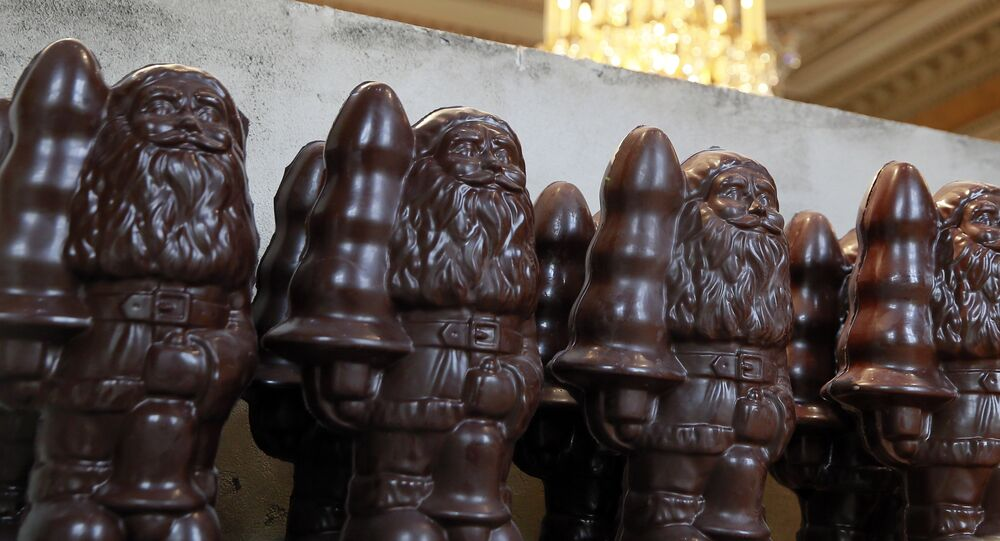 Items made with chocolate are pictured during the presentation of the exhibition Chocolate Factory by US artist Paul McCarthy at the Hotel de la Monnaie in Paris on October 24, 2014 in Paris