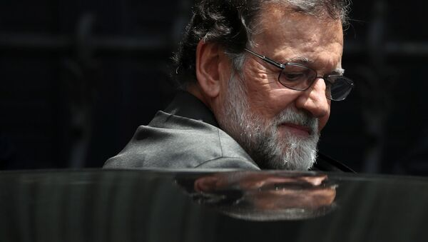 Spain's Prime Minister Mariano Rajoy gets into his car during a lunch break in a motion of no confidence debate at Parliament in Madrid, Spain, May 31, 2018 - Sputnik International