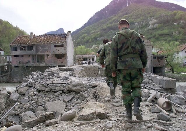 Yugoslav soldiers walk on Murino bridge alledgedly damaged by NATO air strikes, some 130 km from Podgorica, May 2, 1999