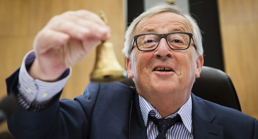 EU Commission President Jean-Claude Juncker rings the bell as he opens the college of commissioners at EU headquarters in Brussels, Wednesday, May 23, 2018