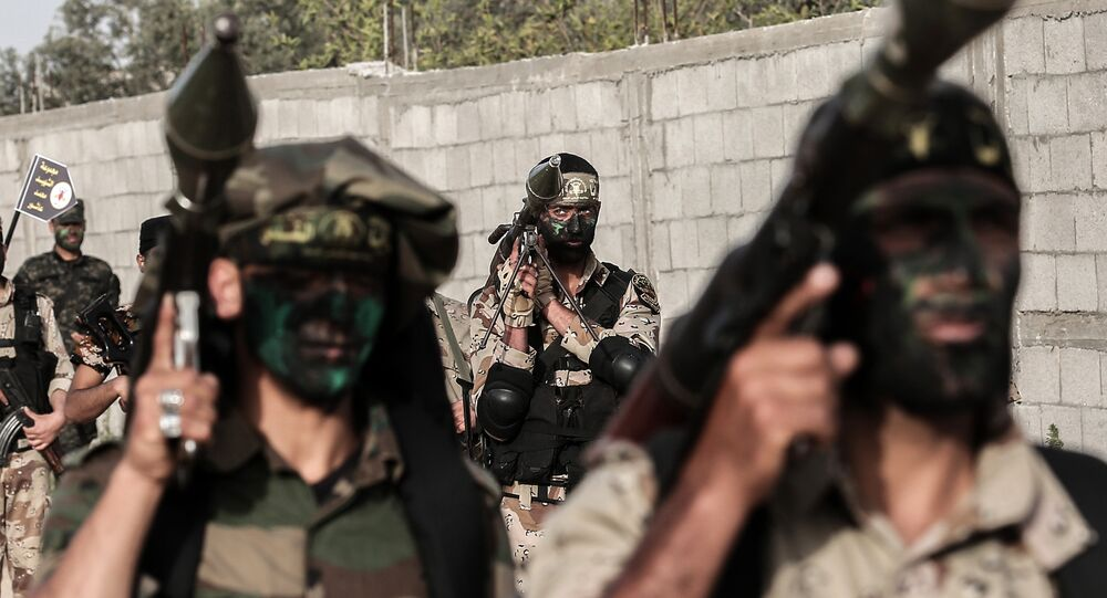 Members of the Palestinian Islamic Jihad movement march with rocket-propelled grenade (RPG) launchers during a military drill in Khan Yunis in the southern Gaza Strip March 27, 2018