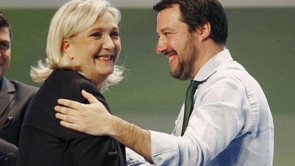 French National Front president Marine Le Pen, left, hugs Italy's Northern League leader Matteo Salvini during the Europe of Nations and Freedom movement meeting in Milan, Italy, Thursday, Jan. 28, 2016 - Sputnik International