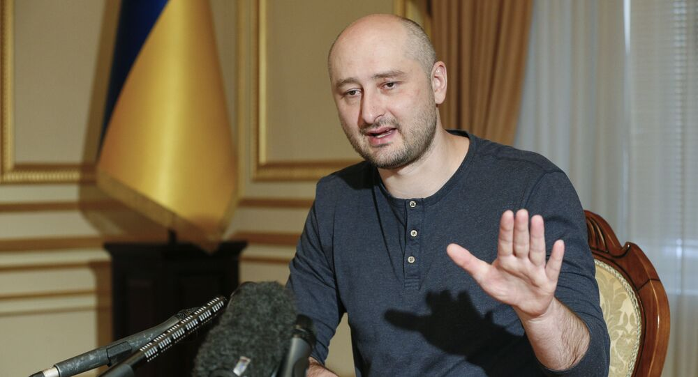 Russian journalist Arkady Babchenko speaks during an interview with foreign media in Kiev, Ukraine, Thursday, May 31, 2018