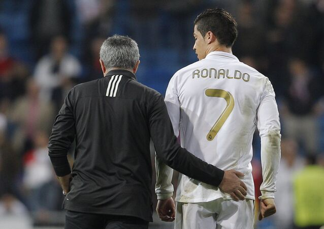 Real Madrid's coach Jose Mourinho from Portugal embraces Cristiano Ronaldo from Portugal after a Champions League round of 16, second leg soccer match against CSKA Moscow's at the Santiago Bernabeu Stadium, in Madrid, Wednesday, March 14, 2012