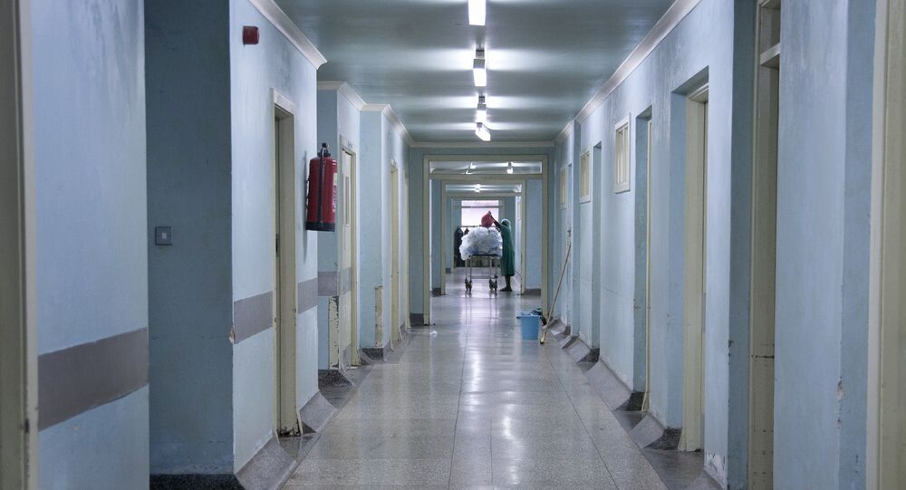 This photo taken Wednesday, Aug. 20, 2014 shows the rundown corridors of the general operating wing at the Mulago National Referral Hospital in Kampala, Uganda.