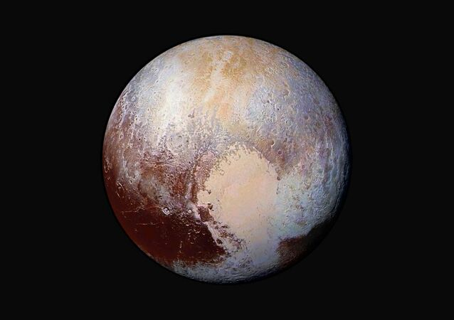 The planet Pluto is pictured in a handout image made up of four images from New Horizons' Long Range Reconnaissance Imager (LORRI) taken in July 2015 combined with color data from the Ralph instrument to create this enhanced color global view