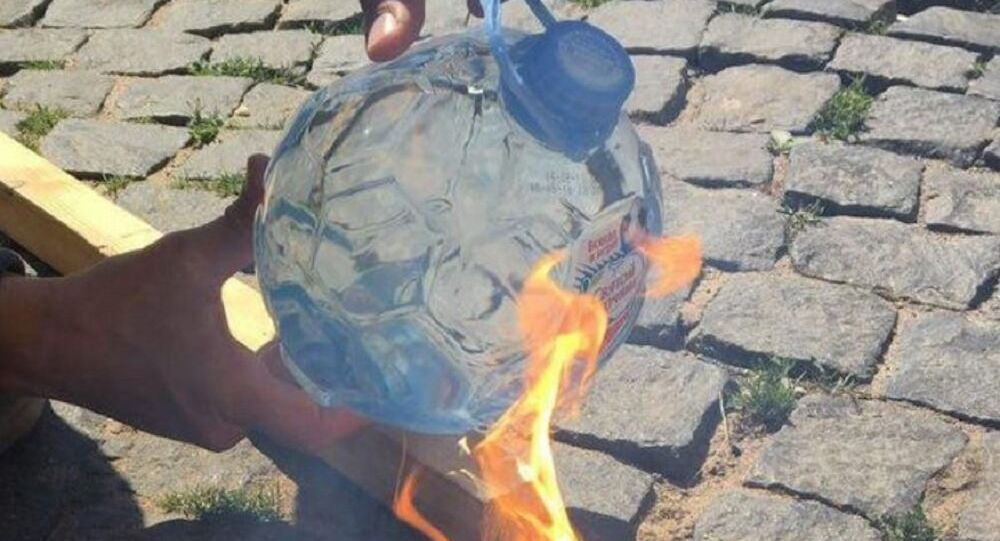 A Holy Spring bottle catching fire in the Sun.