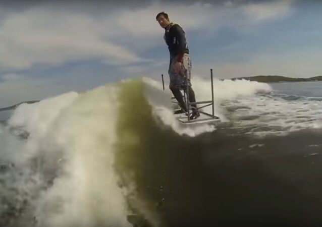 Guy Wakeboards with Table