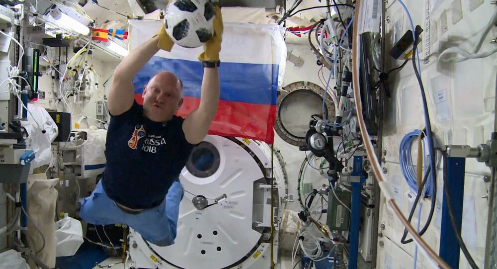 The Roskosmos astronaut  Oleg Artemyev holds a soccer training on the International Space Station
