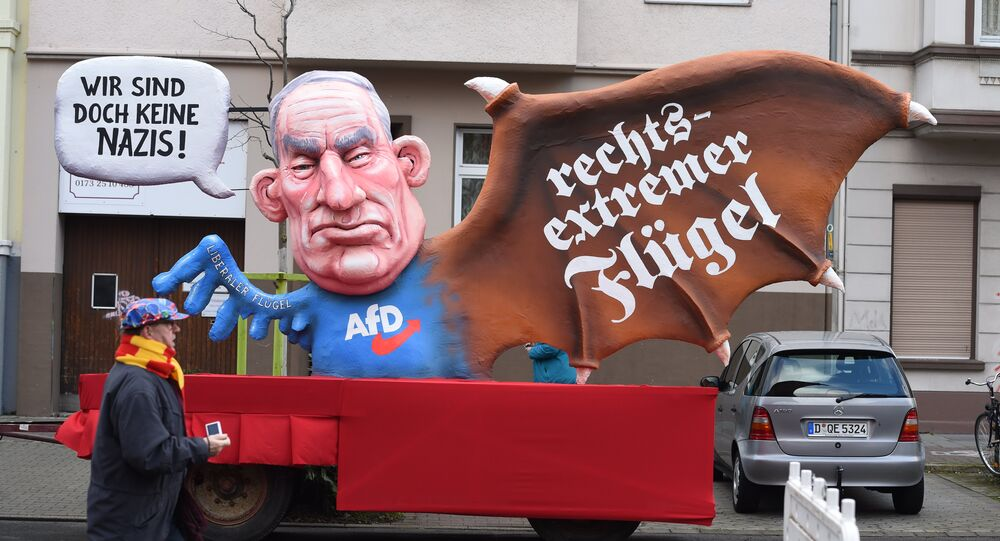 A carnival float, depicting co-leader of the parliamentary group of the Alternative for Germany (AfD) far-right party Alexander Gauland, is pictured during a carnival parade on Rose Monday on February 12, 2018 in Duesseldorf, western Germany. The writings read We are not nazis at all (L) and far-right wing(R)