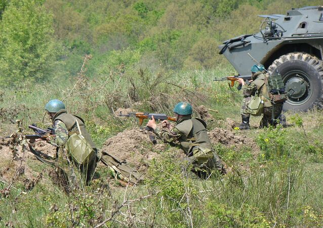 Romanian troops next to a TAB-77 APC during a military exercise of the 191st Infantry Battalion