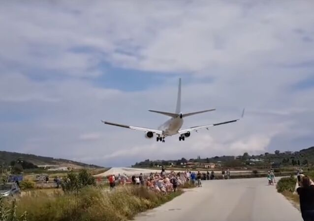 Exciting Moment British tourist 'blown away' by jet blast during takeoff
