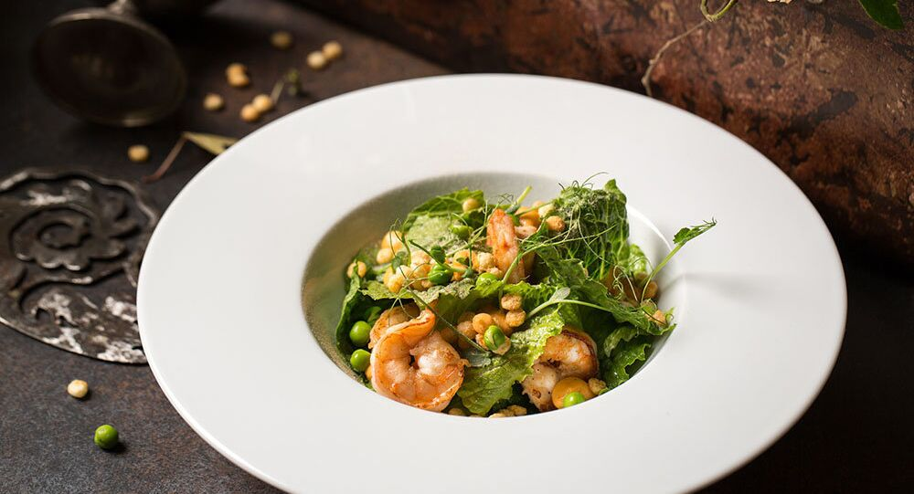 Baran-Rapan's Salad with shrimps, popped ckousckous, avocado, green peas, and citrus dressing