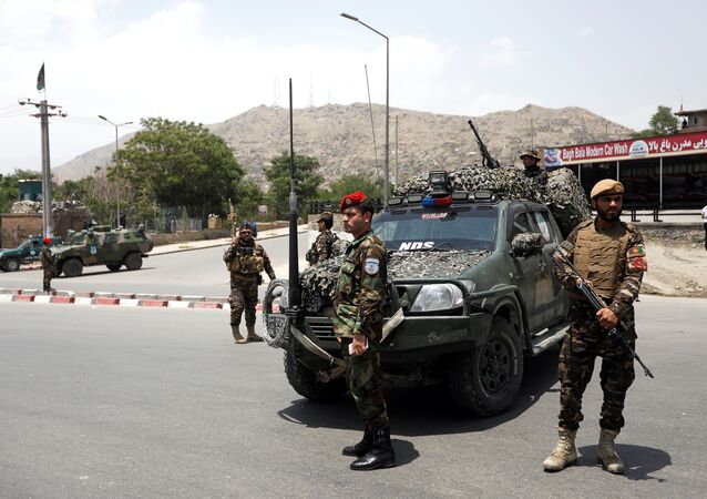 Afghan security forces keep watch at the site of a suicide attack in Kabul, Afghanistan June 4, 2018