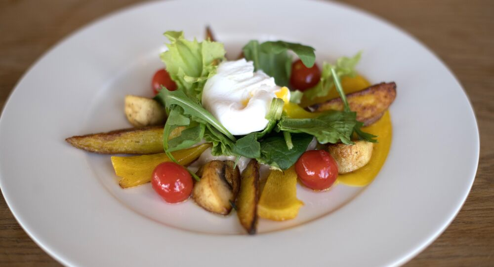Rostov-on-Don Green Café's Warm Mmushroom salad with, baked potato and poached egg warm salad