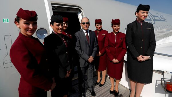 Qatar Airways Chief Executive Officer Akbar al-Baker poses with cabin crew in an Airbus A350-1000 at the Eurasia Airshow in the Mediterranean resort city of Antalya, Turkey April 25, 2018 - Sputnik International