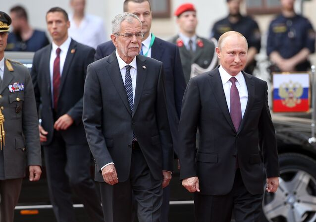 Russian President Vladimir Putin and President of Austria Alexander Van der Bellen, second left, during the official meeting held at Hofburg palace in Vienna