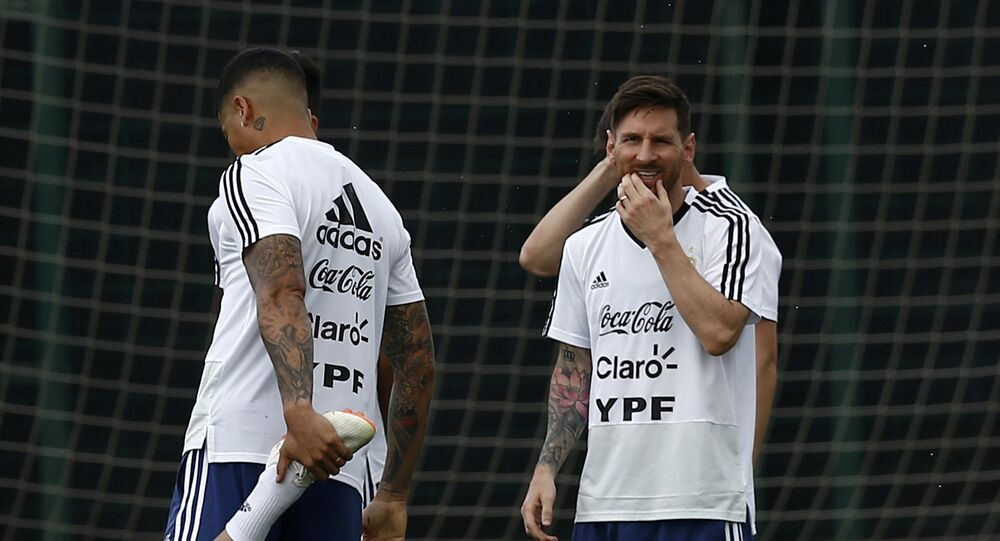 Argentina's Lionel Messi, right, attends a team training session at the Sports Center FC Barcelona Joan Gamper, in Sant Joan Despi, Spain, Wednesday, June 6, 2018