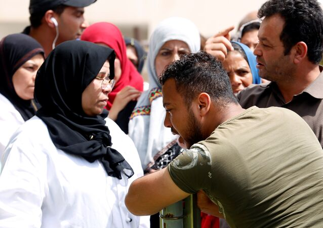 A relative of Tunisian migrants, who drowned when their boat sank, reacts as he leaves a hospital morgue after identifying the bodies of his family members, in Sfax, Tunisia June 4, 2018