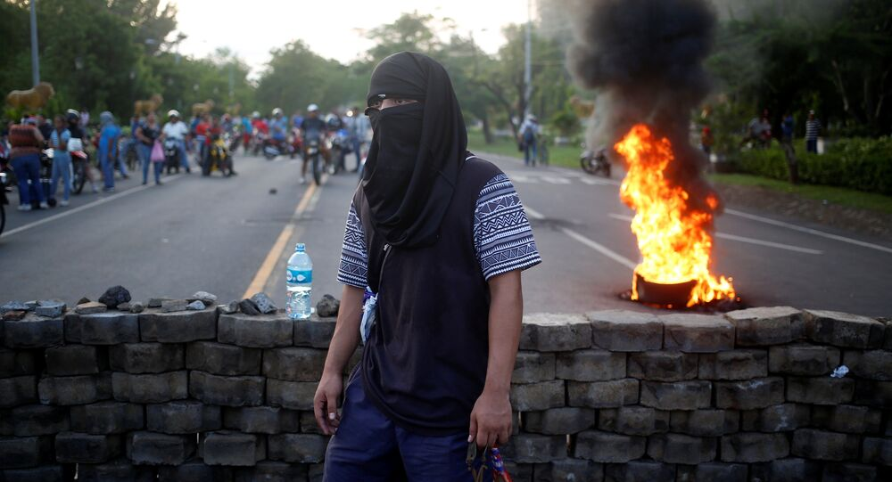 A masked protester takes part in a protest against President Daniel Ortega's government in Leon, Nicaragua