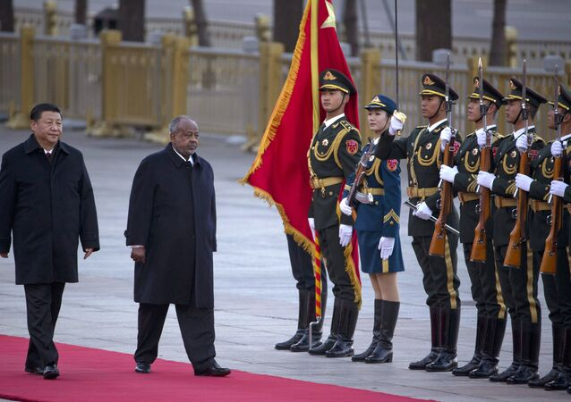 Djibouti's President Ismail Omar Guelleh, second from left walks with Chinese President Xi Jinping during a welcome ceremony held outside the Great Hall of the People in Beijing.