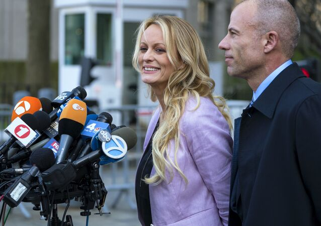 Adult film actress Stormy Daniels speaks to members of the media after a hearing at federal court, Monday, April 16, 2018, in New York, as she is accompanied by her attorney Michael Avenatti.