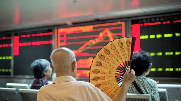 Investors look at screens showing stock market movements at a securities company in Beijing on July 28, 2015 - Sputnik International